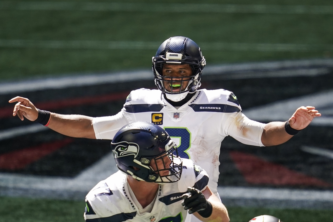 Sep 13, 2020; Atlanta, Georgia, USA; Seattle Seahawks quarterback Russell Wilson (3) looks over the defense  against the Atlanta Falcons during the second half at Mercedes-Benz Stadium. Mandatory Credit: Dale Zanine-USA TODAY Sports