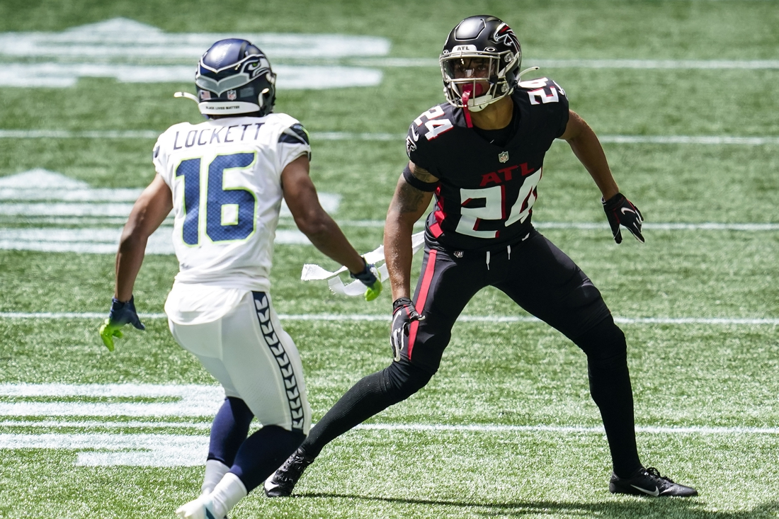 Sep 13, 2020; Atlanta, Georgia, USA; Atlanta Falcons cornerback A.J. Terrell (24) covers Seattle Seahawks wide receiver Tyler Lockett (16) during the second half at Mercedes-Benz Stadium. Mandatory Credit: Dale Zanine-USA TODAY Sports