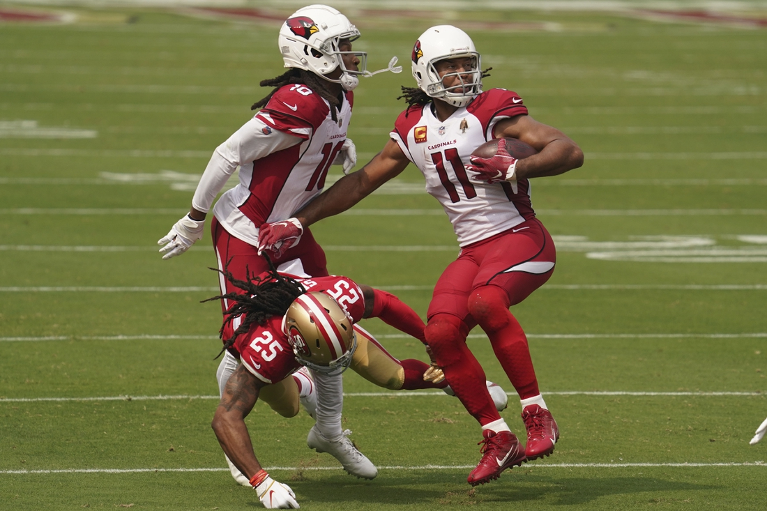September 13, 2020; Santa Clara, California, USA; Arizona Cardinals wide receiver Larry Fitzgerald (11) runs in front of wide receiver DeAndre Hopkins (10) against San Francisco 49ers cornerback Richard Sherman (25) during the first quarter at Levi's Stadium. Mandatory Credit: Kyle Terada-USA TODAY Sports
