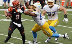 Sep 13, 2020; Cincinnati, Ohio, USA; Cincinnati Bengals quarterback Joe Burrow (9) is sacked by Los Angeles Chargers defensive tackle Jerry Tillery (99) during the first half at Paul Brown Stadium. Mandatory Credit: David Kohl-USA TODAY Sports