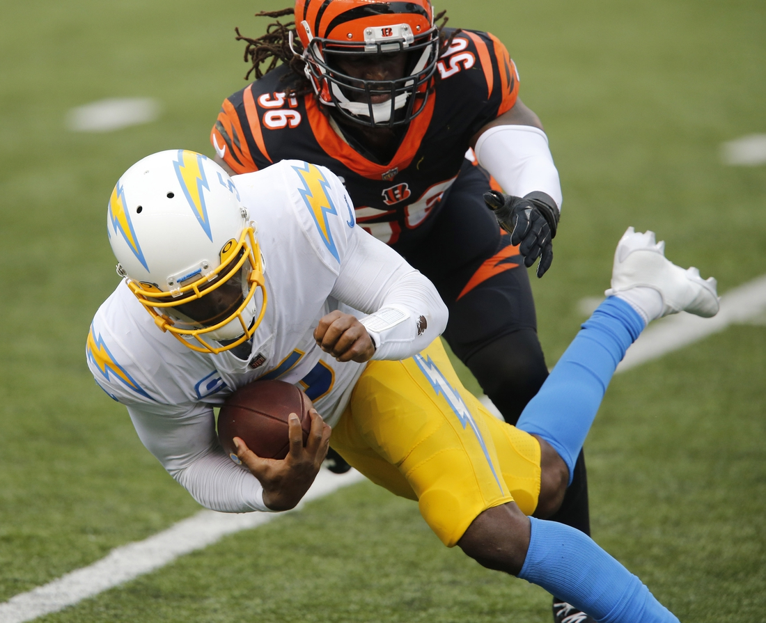 Sep 13, 2020; Cincinnati, Ohio, USA; Los Angeles Chargers quarterback Tyrod Taylor (5) tackled by Los Angeles Chargers linebacker Kenneth Murray (56) during the second half at Paul Brown Stadium. Mandatory Credit: Joseph Maiorana-USA TODAY Sports