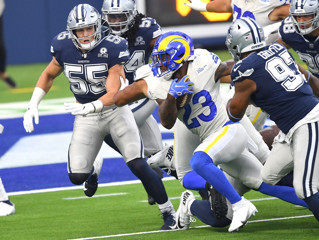 Sep 13, 2020; Inglewood, California, USA; Dallas Cowboys outside linebacker Leighton Vander Esch (55) and Dallas Cowboys defensive end Everson Griffen (97) chase down Los Angeles Rams running back Cam Akers (23) as he runs for a first down in the first quarter of the game at SoFi. Mandatory Credit: Jayne Kamin-Oncea-USA TODAY Sports