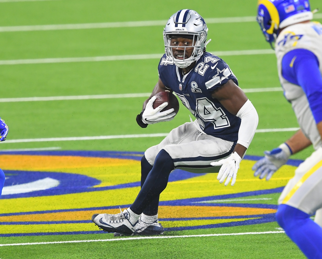 Sep 13, 2020; Inglewood, California, USA; Dallas Cowboys cornerback Chidobe Awuzie (24) hangs on to the ball after he intercepted a pass intended for Los Angeles Rams wide receiver Van Jefferson (12) in the second half of the game at SoFi Stadium. Mandatory Credit: Jayne Kamin-Oncea-USA TODAY Sports