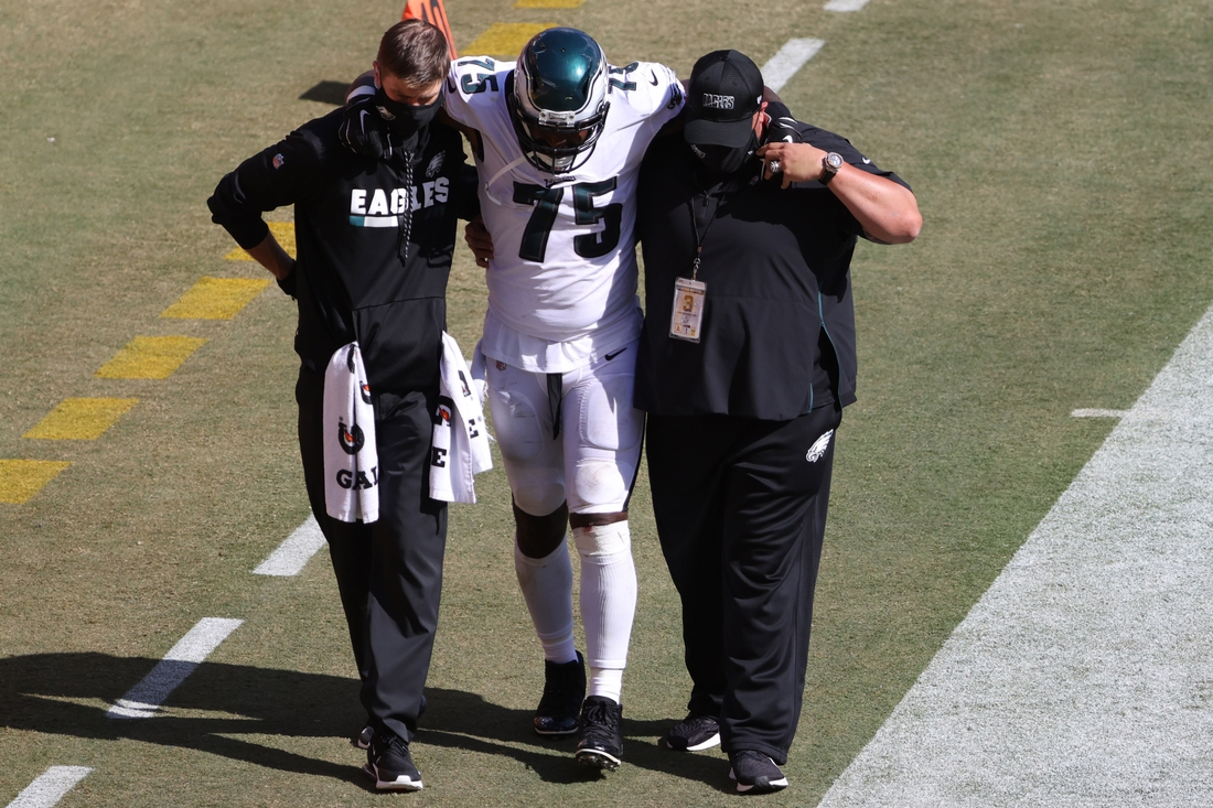 Sep 13, 2020; Landover, Maryland, USA; Philadelphia Eagles defensive end Vinny Curry (75) is helped off the field after being injured against the Washington Football Team at FedExField. Mandatory Credit: Geoff Burke-USA TODAY Sports