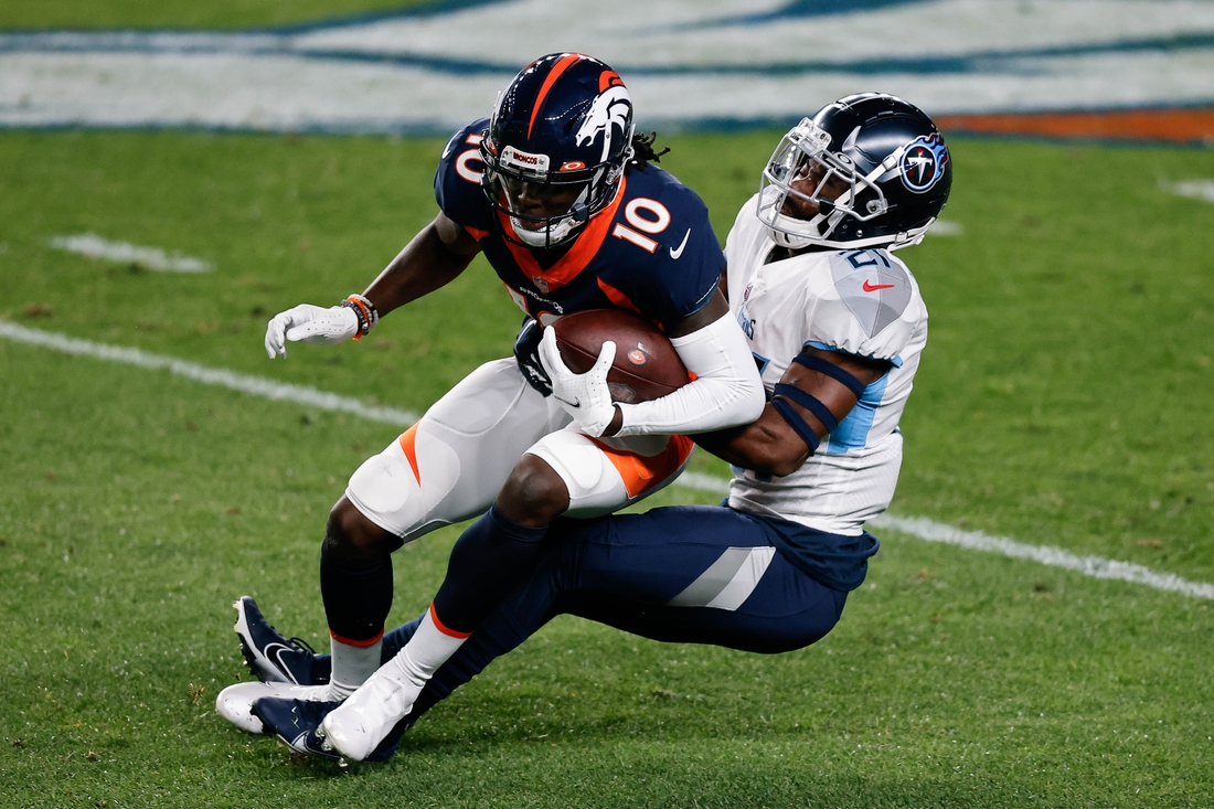 Sep 14, 2020; Denver, Colorado, USA; Denver Broncos wide receiver Jerry Jeudy (10) is tackled by Tennessee Titans cornerback Malcolm Butler (21) in the first quarter at Empower Field at Mile High. Mandatory Credit: Isaiah J. Downing-USA TODAY Sports