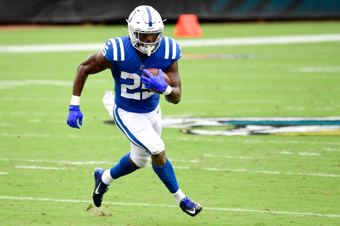 Sep 13, 2020; Jacksonville, Florida, USA; Indianapolis Colts running back Marlon Mack (25) runs with the ball during the first quarter against the Jacksonville Jaguars at TIAA Bank Field. Mandatory Credit: Douglas DeFelice-USA TODAY Sports