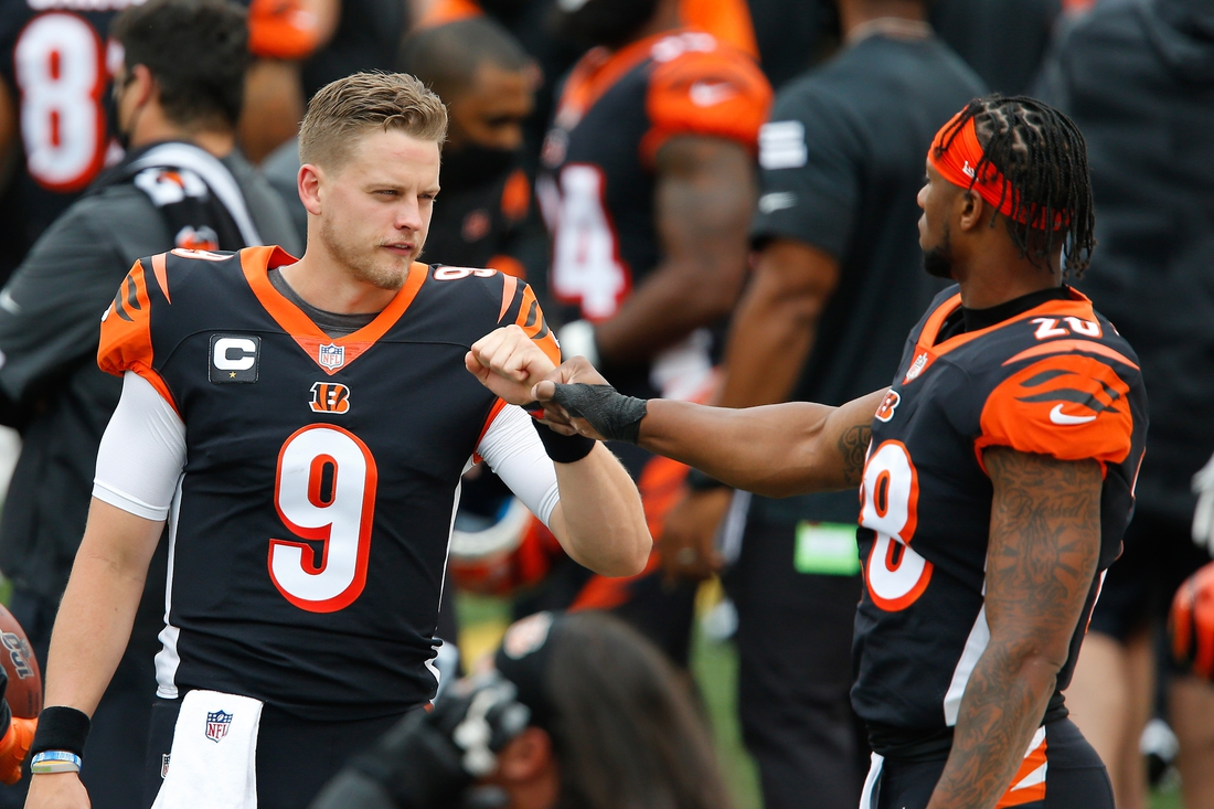 Sep 13, 2020; Cincinnati, Ohio, USA; Cincinnati Bengals quarterback Joe Burrow (9) fist bumps running back Joe Mixon (28) before the game against the Los Angeles Chargers at Paul Brown Stadium. Mandatory Credit: Joseph Maiorana-USA TODAY Sports