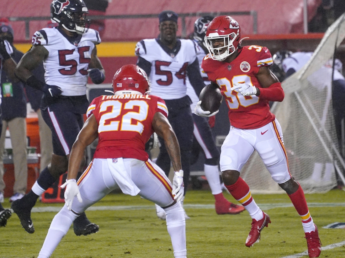 Sep 10, 2020; Kansas City, Missouri, USA; Kansas City Chiefs safety L'Jarius Sneed (38) celebrates with safety Juan Thornhill (22) after intercepting during the game against the Houston Texans at Arrowhead Stadium. Mandatory Credit: Denny Medley-USA TODAY Sports