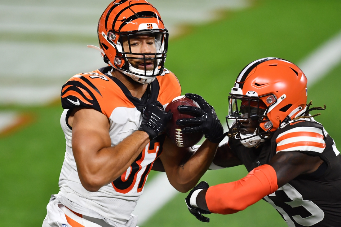Sep 17, 2020; Cleveland, Ohio, USA; Cincinnati Bengals tight end C.J. Uzomah (87) catches a touchdown over the defense of Cleveland Browns defensive back Ronnie Harrison (33) during the first half at FirstEnergy Stadium. Mandatory Credit: Ken Blaze-USA TODAY Sports