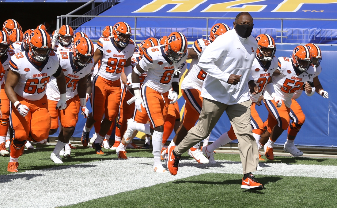 Sep 19, 2020; Pittsburgh, Pennsylvania, USA;  Syracuse Orange head coach Dino Babers leads the team onto the field toppled the Pittsburgh Panthers at Heinz Field. Mandatory Credit: Charles LeClaire-USA TODAY Sports