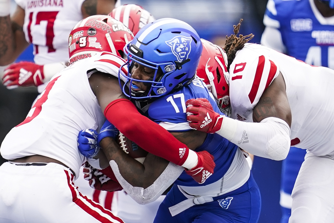 Sep 19, 2020; Atlanta, Georgia, USA; Georgia State Panthers running back Destin Coates (17) is tackled by Louisiana-Lafayette Ragin Cajuns safety Percy Butler (9)  and linebacker Andre Jones (10) during the first quarter at Center parc Stadium. Mandatory Credit: Dale Zanine-USA TODAY Sports