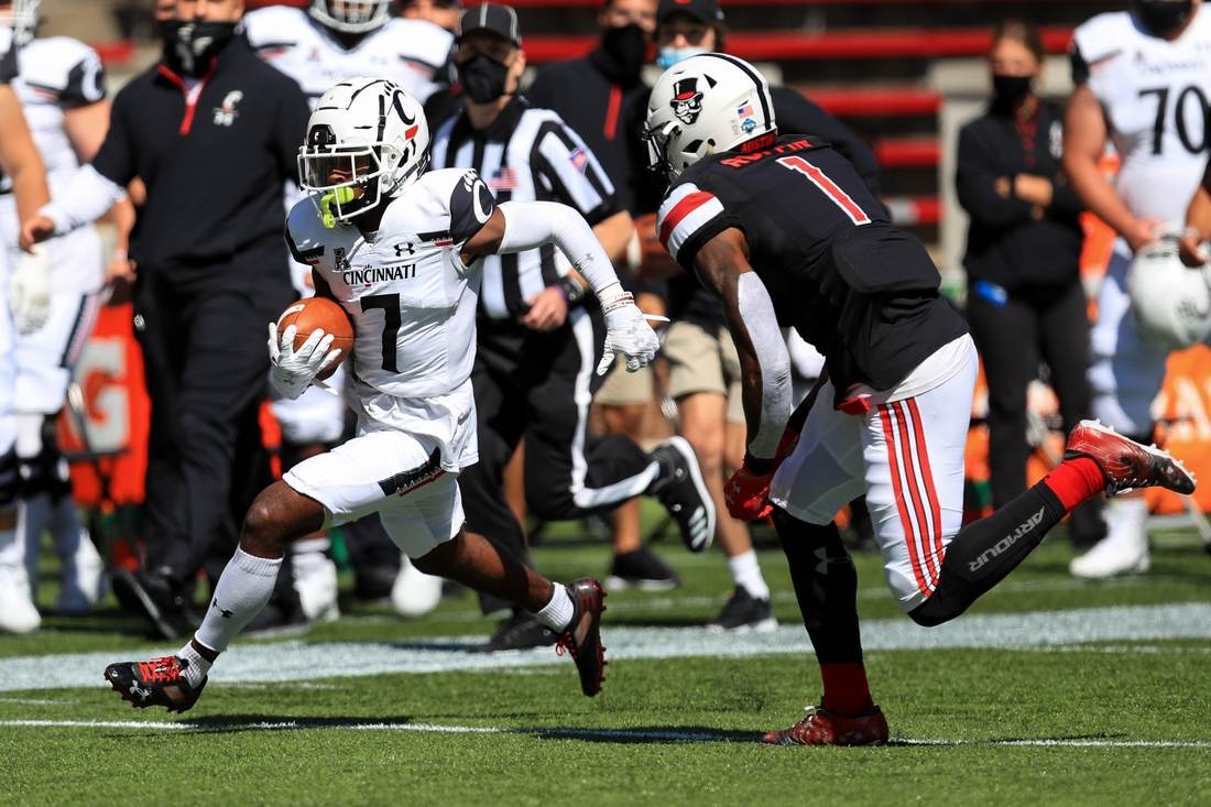 Sep 19, 2020; Cincinnati, Ohio, USA; Cincinnati Bearcats wide receiver Tre Tucker (7) carries the ball for a touchdown against the Austin Peay Governors in the first half at Nippert Stadium. Mandatory Credit: Aaron Doster-USA TODAY Sports