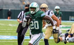Sep 19, 2020; New Orleans, Louisiana, USA; Tulane Green Wave running back Cameron Carroll (20) runs past Navy Midshipmen linebacker Tommy Lawley (46) for a touchdown during the first half at Yulman Stadium. Mandatory Credit: Derick E. Hingle-USA TODAY Sports