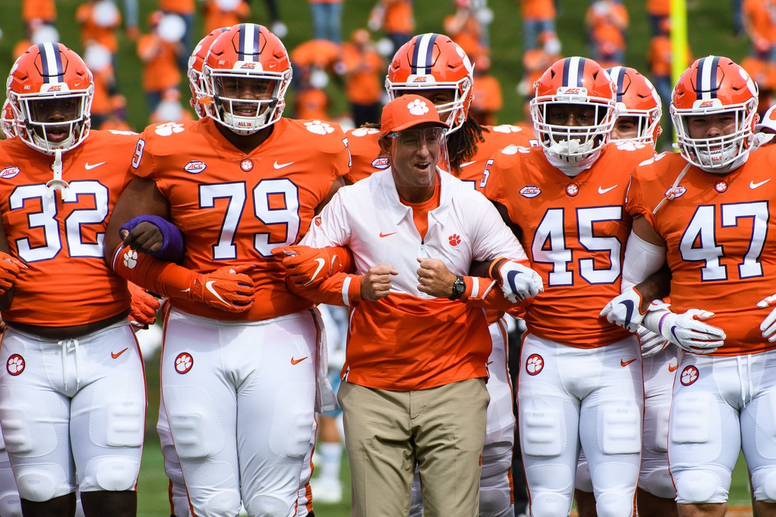 Sep 19, 2020; Clemson, SC, USA; Clemson head coach Dabo Swinney walks with his players during the walk of champions before their game against The Citadel on Saturday, Sept. 19, 2020.  Mandatory Credit: Ken Ruinard/Greenville News-USA TODAY NETWORK