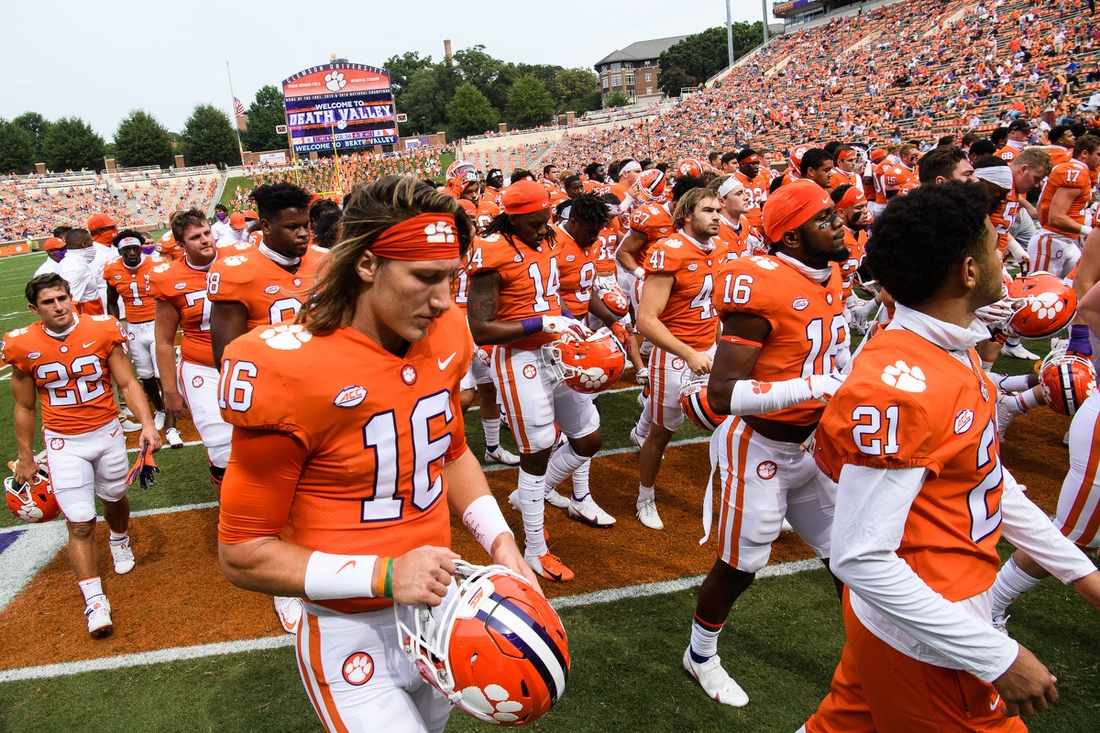 Sep 19, 2020; Clemson, SC, USA; Clemson quarterback Trevor Lawrence(16) and other players walk off the field after warmups before their game against The Citadel on Saturday, Sept. 19, 2020. Mandatory Credit: Ken Ruinard/Greenville News-USA TODAY NETWORK