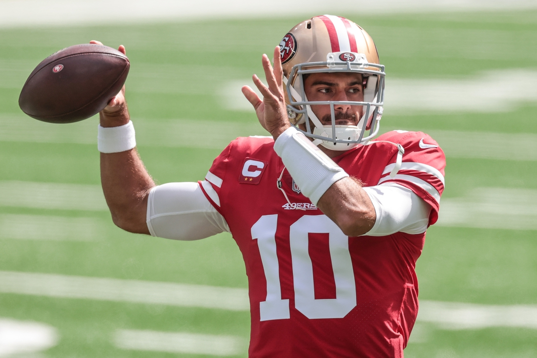 Sep 20, 2020; East Rutherford, New Jersey, USA;  San Francisco 49ers quarterback Jimmy Garoppolo (10) throws a pass before his game against the New York Jets at MetLife Stadium. Mandatory Credit: Vincent Carchietta-USA TODAY Sports