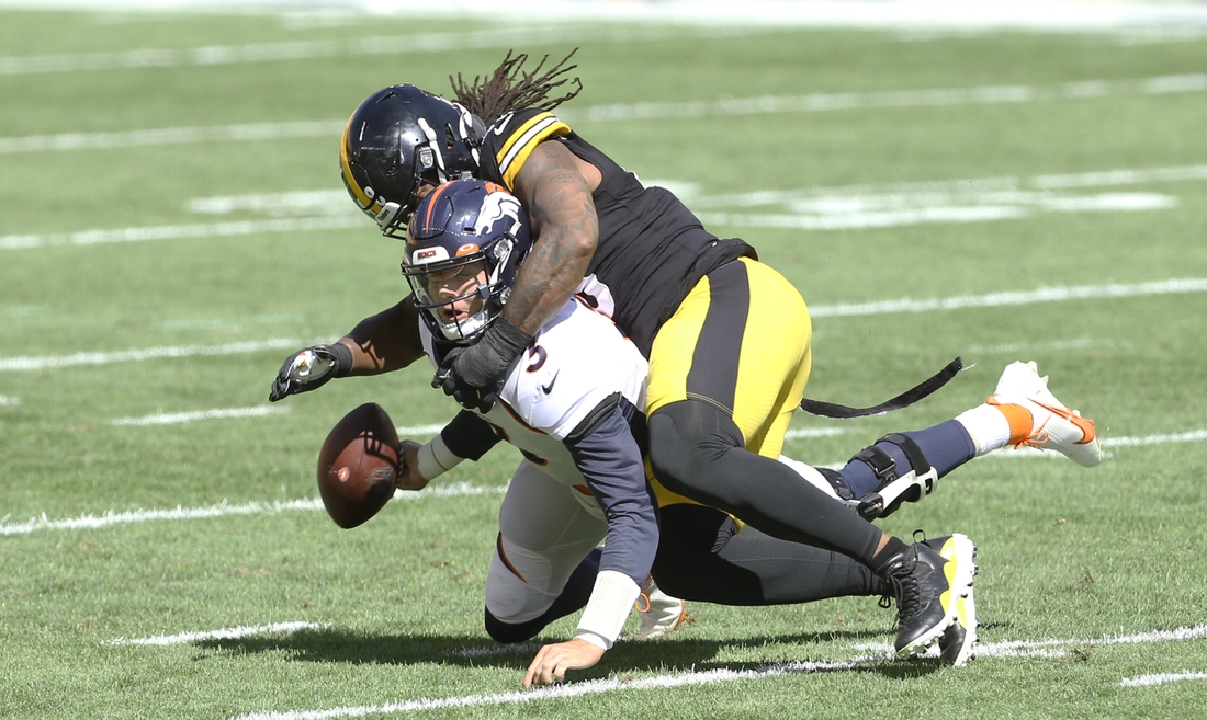 Sep 20, 2020; Pittsburgh, Pennsylvania, USA; Pittsburgh Steelers outside linebacker Bud Dupree (48) sacks Denver Broncos quarterback Drew Lock (3) causing a fumble during the first quarter at Heinz Field. Lock would leave the game. Mandatory Credit: Charles LeClaire-USA TODAY Sports