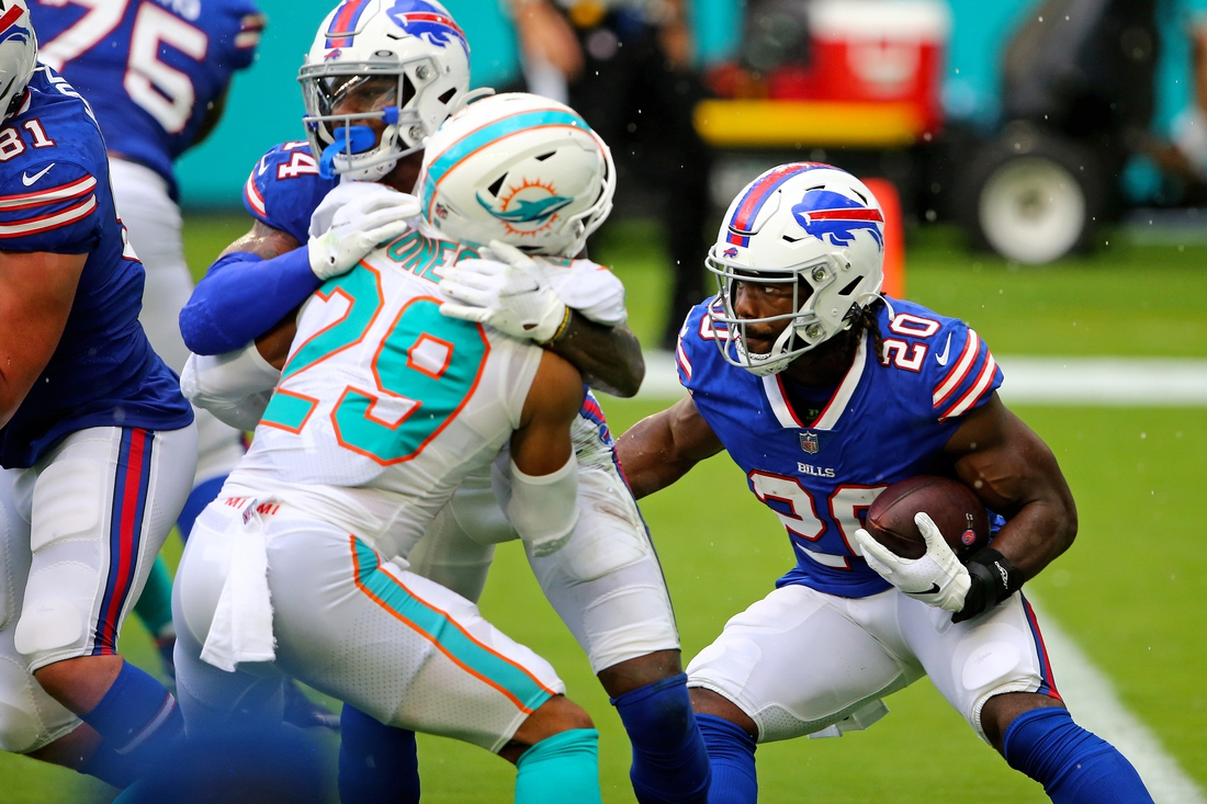 Sep 20, 2020; Miami Gardens, Florida, USA; Buffalo Bills running back Zack Moss (20) runs the ball against the Miami Dolphins during the first half at Hard Rock Stadium. Mandatory Credit: Jasen Vinlove-USA TODAY Sports