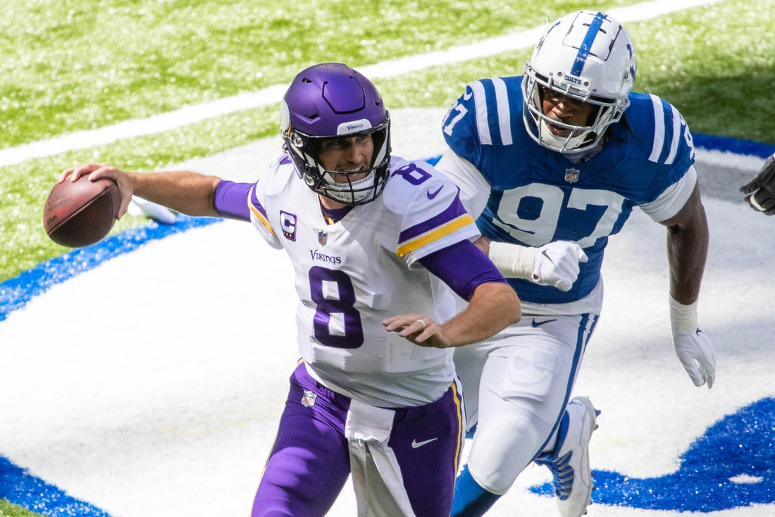 Sep 20, 2020; Indianapolis, Indiana, USA; Minnesota Vikings quarterback Kirk Cousins (8) passes the ball while Indianapolis Colts defensive end Al-Quadin Muhammad (97) defends in the first quarter at Lucas Oil Stadium. Mandatory Credit: Trevor Ruszkowski-USA TODAY Sports