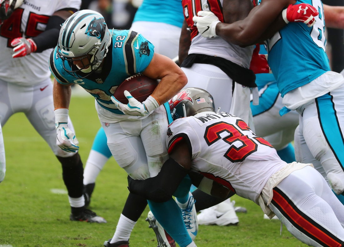 Sep 20, 2020; Tampa, Florida, USA; Carolina Panthers running back Christian McCaffrey (22) runs the ball against the Tampa Bay Buccaneers  during the third quarter at Raymond James Stadium. Mandatory Credit: Kim Klement-USA TODAY Sports