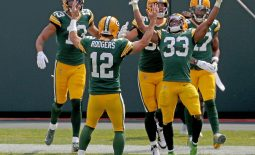 Sep 20, 2020; Green Bay, WI, USA;  Green Bay Packers quarterback Aaron Rodgers (12) and Green Bay Packers running back Aaron Jones (33) celebrate Jones' long touchdown run with teammates during the 3rd quarter of the Green Bay Packers game against the Detroit Lions at Lambeau Field in Green Bay on Sunday, Sept. 20, 2020. Mandatory Credit: Mike De Sisti/Milwaukee Journal Sentinel-USA TODAY NETWORK