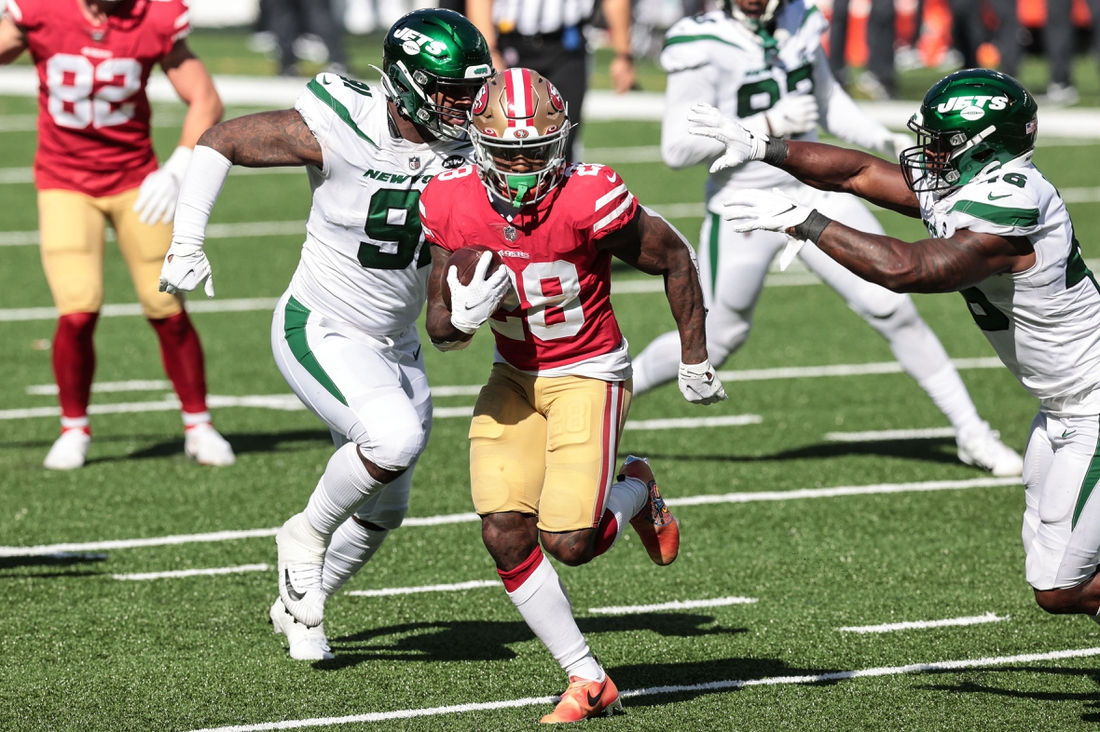 Sep 20, 2020; East Rutherford, New Jersey, USA; San Francisco 49ers running back Jerick McKinnon (28) runs for a touchdown as New York Jets linebacker Neville Hewitt (46) and defensive end John Franklin-Myers (91) pursue during the second half at MetLife Stadium. Mandatory Credit: Vincent Carchietta-USA TODAY Sports