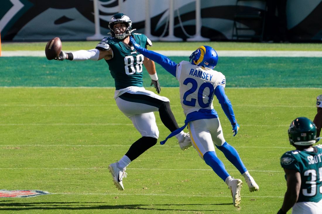 Sep 20, 2020; Philadelphia, Pennsylvania, USA; Philadelphia Eagles tight end Dallas Goedert (88) is unable to catch the ball as Los Angeles Rams cornerback Jalen Ramsey (20) defends during the fourth quarter at Lincoln Financial Field. Mandatory Credit: Bill Streicher-USA TODAY Sports