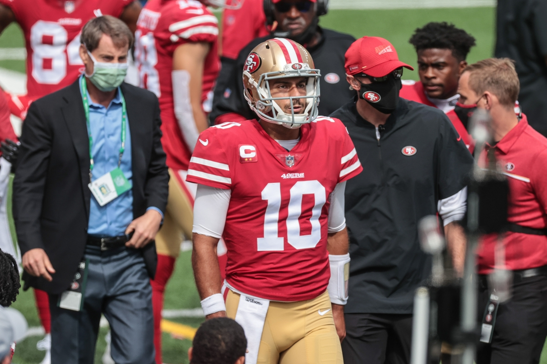Sep 20, 2020; East Rutherford, New Jersey, USA; San Francisco 49ers quarterback Jimmy Garoppolo (10) reacts while walking on the sidelines after injuring his ankle on the previous play during the first half against the New York Jets at MetLife Stadium. Mandatory Credit: Vincent Carchietta-USA TODAY Sports