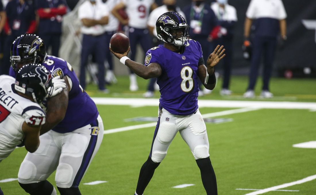 Sep 20, 2020; Houston, Texas, USA; Baltimore Ravens quarterback Lamar Jackson (8) throws the ball during the second quarter against the Houston Texans at NRG Stadium. Mandatory Credit: Troy Taormina-USA TODAY Sports