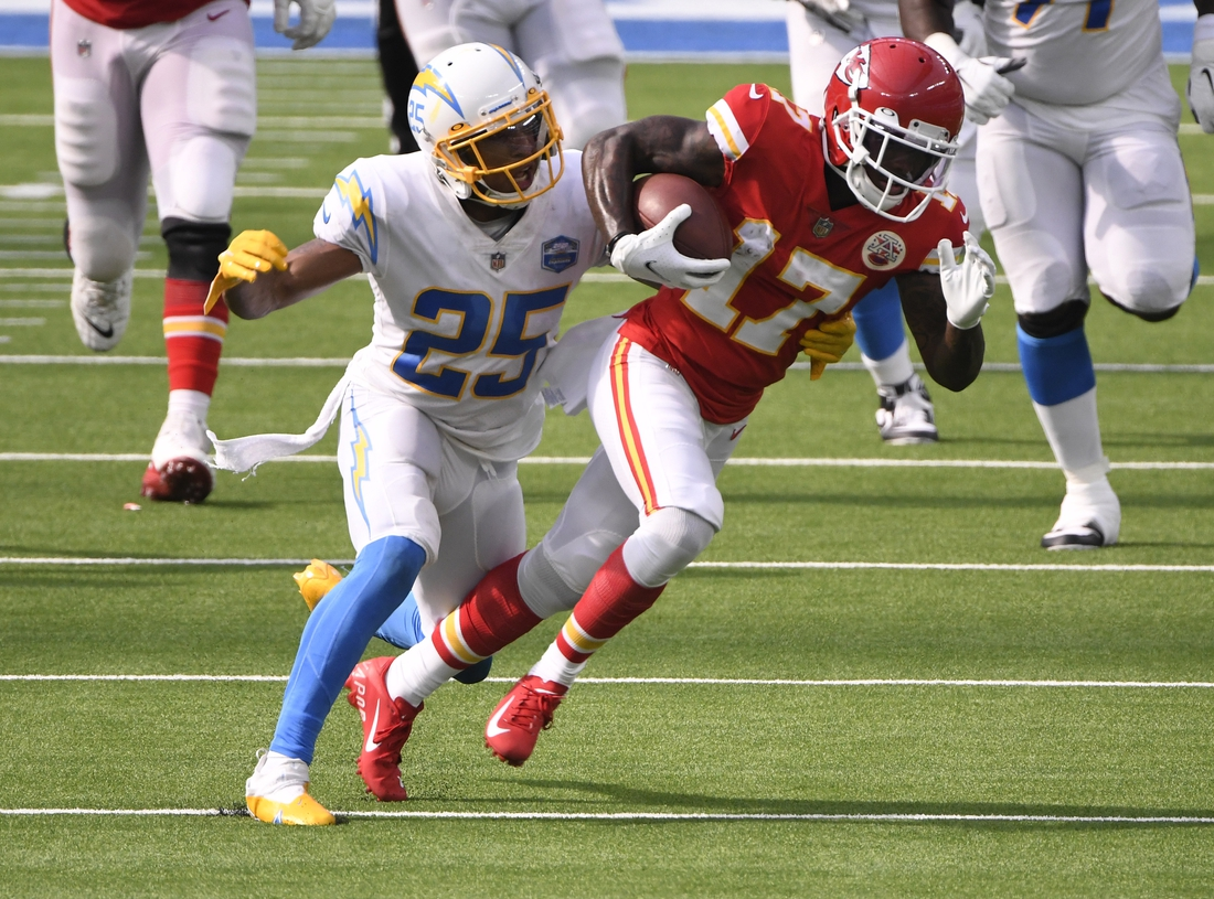 Sep 20, 2020; Inglewood, California, USA;  Kansas City Chiefs wide receiver Mecole Hardman (17) is tackled by Los Angeles Chargers cornerback Chris Harris (25) during the fourth quarter at SoFi Stadium. Mandatory Credit: Robert Hanashiro-USA TODAY Sports
