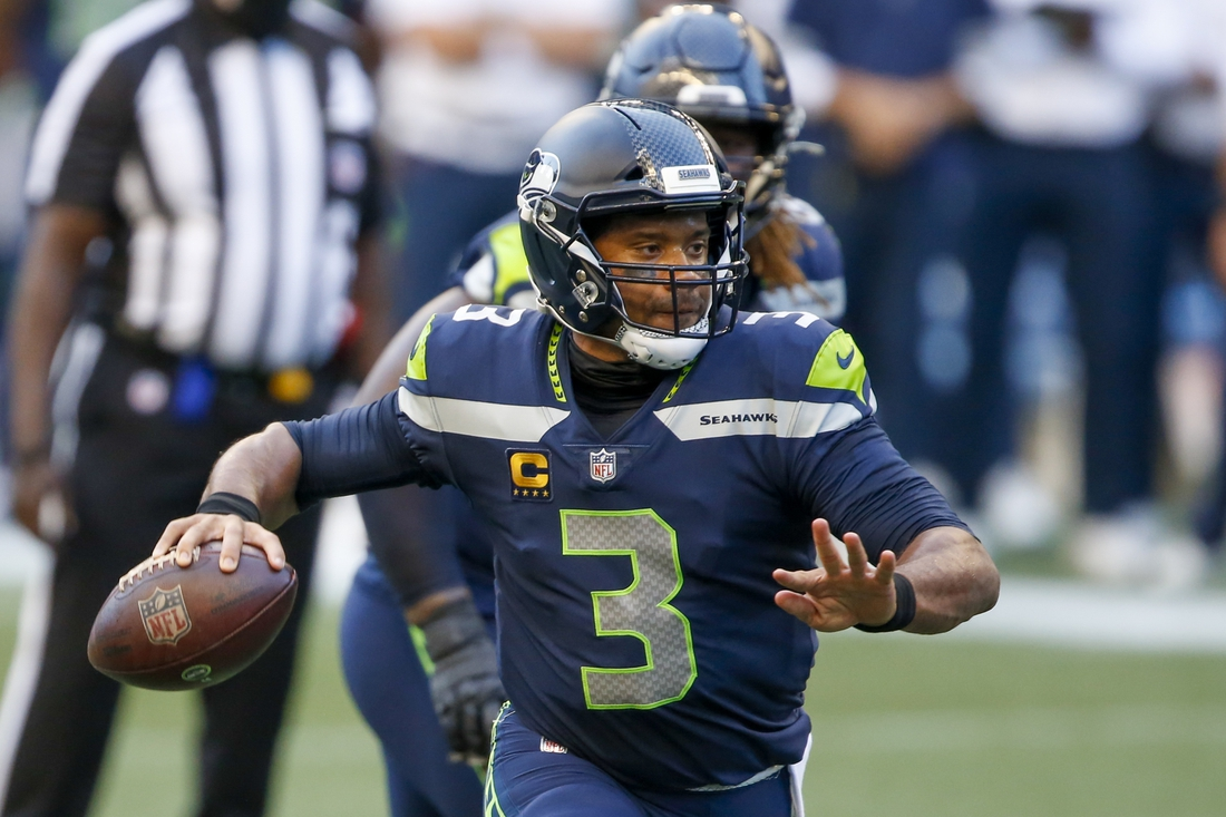 Sep 20, 2020; Seattle, Washington, USA; Seattle Seahawks quarterback Russell Wilson (3) throws a touchdown pass against the New England Patriots during the first quarter at CenturyLink Field. Mandatory Credit: Joe Nicholson-USA TODAY Sports