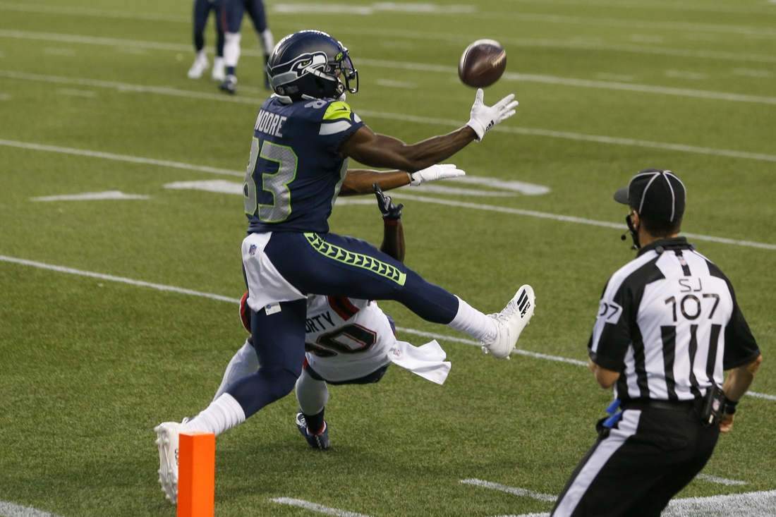 Sep 20, 2020; Seattle, Washington, USA; Seattle Seahawks wide receiver David Moore (83) catches a touchdown against the New England Patriots during the third quarter at CenturyLink Field. Mandatory Credit: Joe Nicholson-USA TODAY Sports