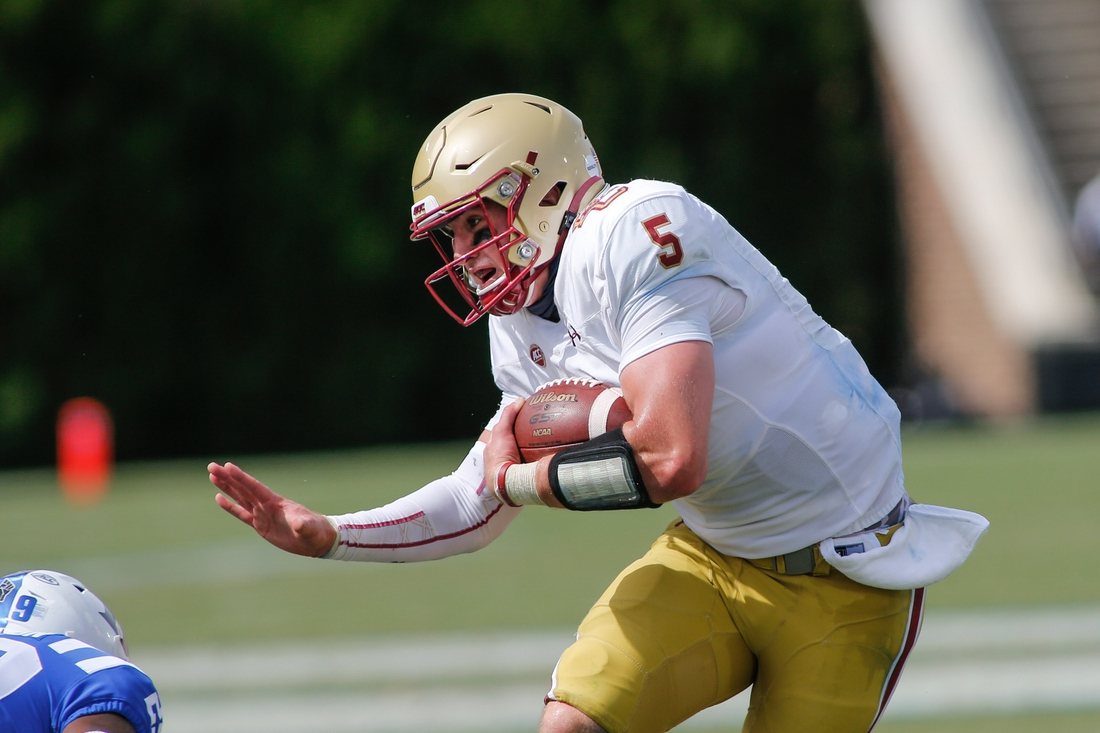 Sep 19, 2020; Durham, North Carolina, USA; Boston College Eagles quarterback Phil Jurkovec (5) carries the football against the Duke Blue Devils in the fourth quarter at Wallace Wade Stadium. The Boston College Eagles won 26-6. Mandatory Credit: Nell Redmond-USA TODAY Sports
