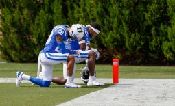 Sep 19, 2020; Durham, North Carolina, USA; Duke Blue Devils cornerback Mark Gilbert (28) kneels with a teammate before the start of an NCAA football game against the Boston College Eagles at Wallace Wade Stadium. The Boston College Eagles won 26-6. Mandatory Credit: Nell Redmond-USA TODAY Sports