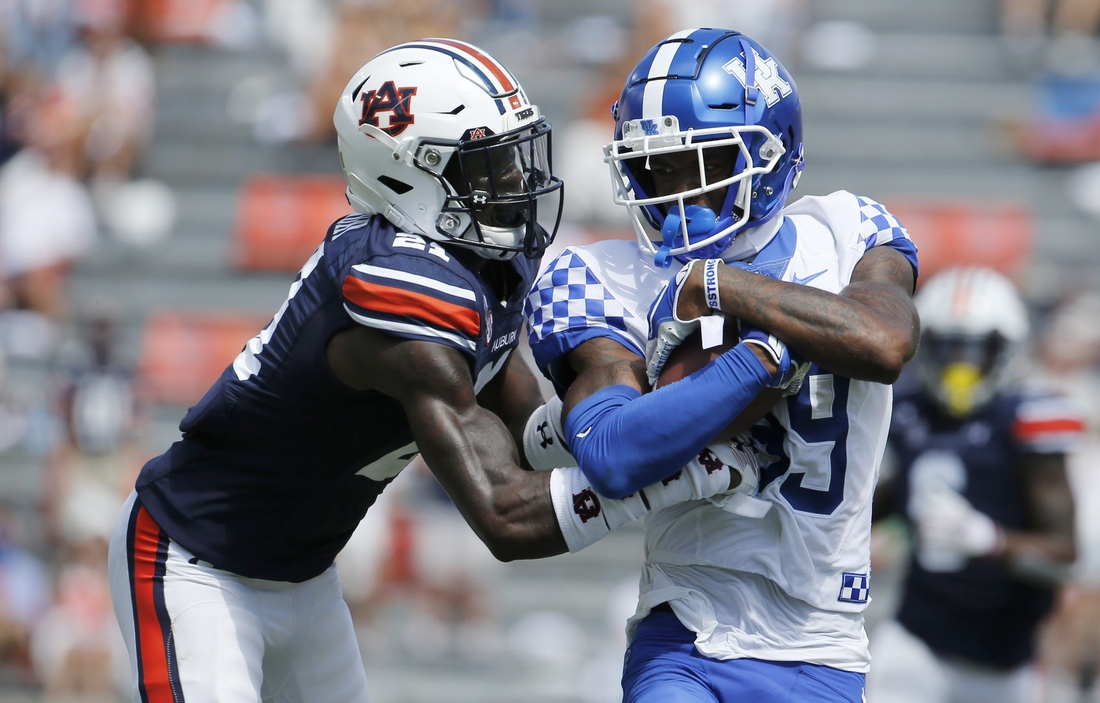 Sep 26, 2020; Auburn, Alabama, USA;  Kentucky Wildcats running back Kavosiey Smoke (20) gets past Auburn Tigers defenders and scores a touchdown during the first quarter at Jordan-Hare Stadium. Mandatory Credit: John Reed-USA TODAY Sports