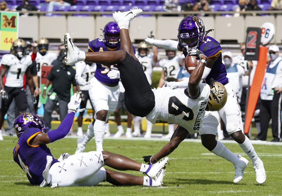 Sep 26, 2020; Greenville, North Carolina, USA;  UCF Knights wide receiver Marlon Williams (6) makes a first half catch against East Carolina Pirates defensive back Malik Fleming (4) and defensive back Juan Powell (14) at Dowdy-Ficklen Stadium. Mandatory Credit: James Guillory-USA TODAY Sports