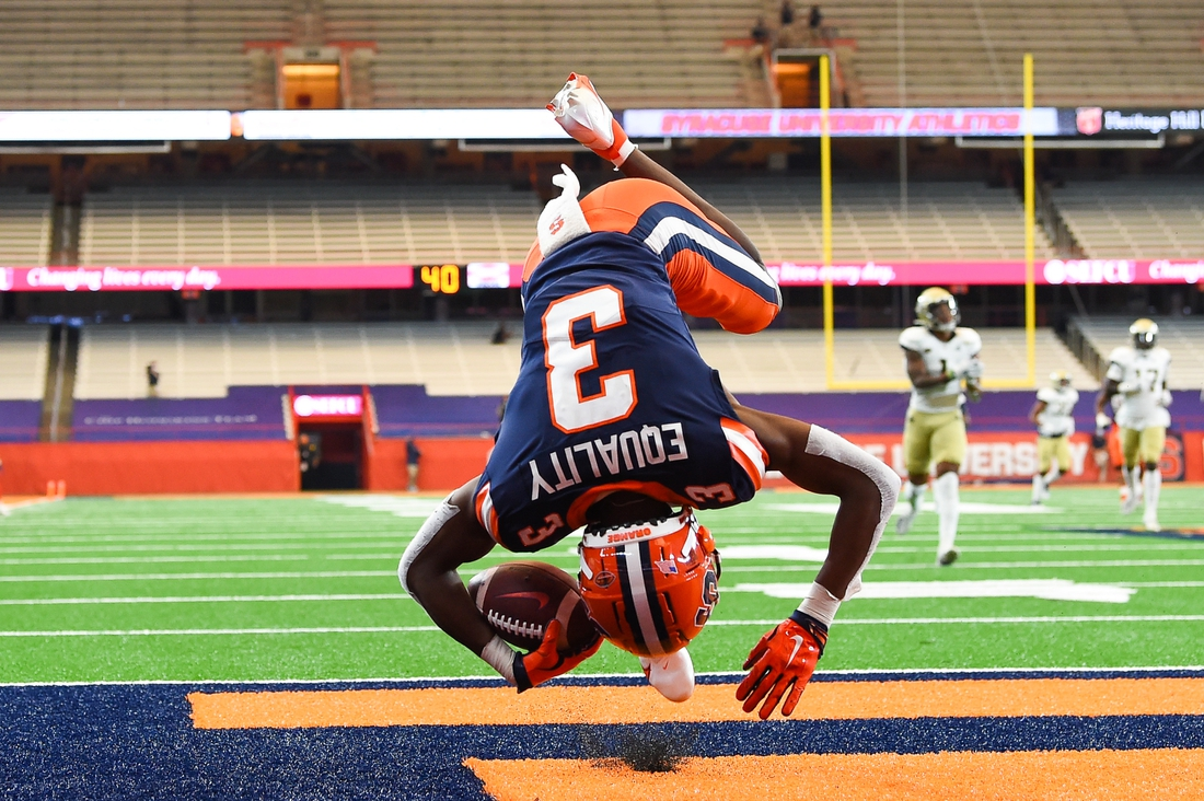 Sep 26, 2020; Syracuse, New York, USA; Syracuse Orange wide receiver Taj Harris (3) does a forward roll in the end zone for a touchdown against the Georgia Tech Yellow Jackets during the second quarter at the Carrier Dome. Mandatory Credit: Rich Barnes-USA TODAY Sports