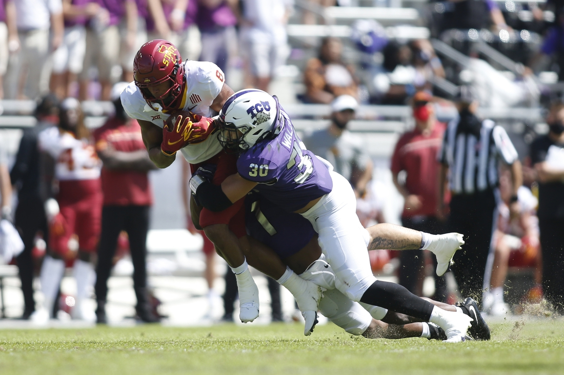 Sep 26, 2020; Fort Worth, Texas, USA; Iowa State Cyclones wide receiver Xavier Hutchinson (8) is tackled by TCU Horned Frogs linebacker Garret Wallow (30) in the second quarter at Amon G. Carter Stadium. Mandatory Credit: Tim Heitman-USA TODAY Sports