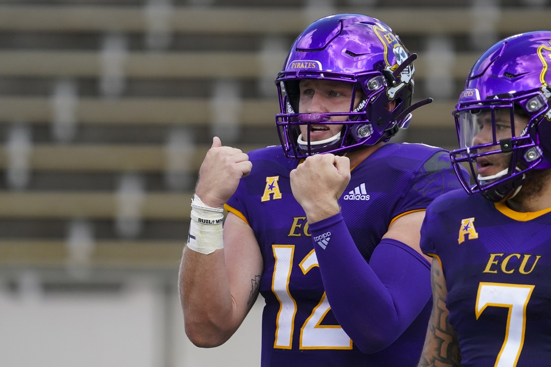 Sep 26, 2020; Greenville, North Carolina, USA;  East Carolina Pirates quarterback Holton Ahlers (12) reacts against the UCF Knights during the first half at Dowdy-Ficklen Stadium. Mandatory Credit: James Guillory-USA TODAY Sports
