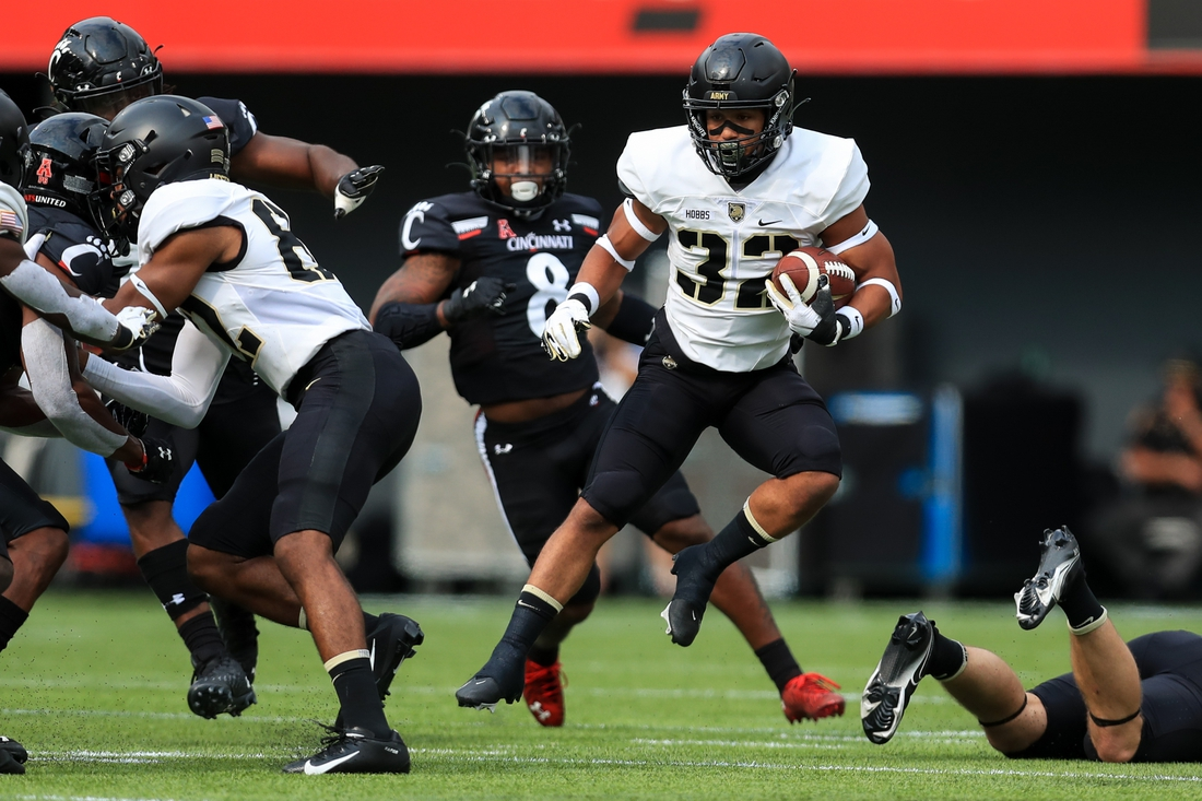 Sep 26, 2020; Cincinnati, Ohio, USA; Army Black Knights running back Artice Hobbs IV (32) carries the ball against the Cincinnati Bearcats in the first half at Nippert Stadium. Mandatory Credit: Aaron Doster-USA TODAY Sports