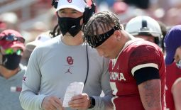 Sep 26, 2020; Norman, Oklahoma, USA;  Oklahoma Sooners quarterback Spencer Rattler (7) speaks with head coach Lincoln Riley during the second half against the Kansas State Wildcats at Gaylord Family Oklahoma Memorial Stadium. Mandatory Credit: Kevin Jairaj-USA TODAY Sports