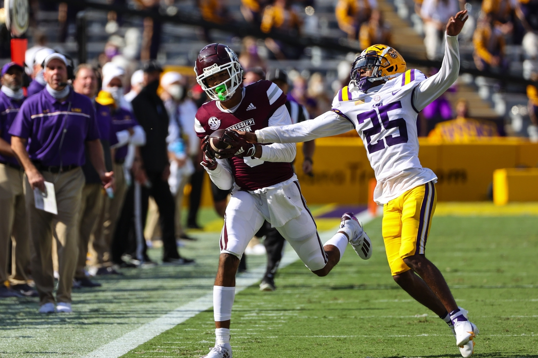 Sep 26, 2020; Baton Rouge, Louisiana, USA; Mississippi State Bulldogs wide receiver Osirus Mitchell (5) catches a pass past LSU Tigers cornerback Cordale Flott (25) during the first half at Tiger Stadium. Mandatory Credit: Derick E. Hingle-USA TODAY Sports