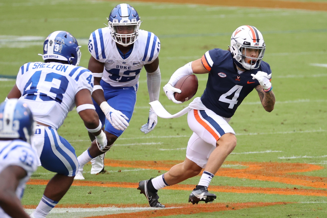 Sep 26, 2020; Charlottesville, Virginia, USA; Virginia Cavaliers running back Billy Kemp IV (4) runs with the ball past Duke Blue Devils linebacker Rocky Shelton II (43) in the first quarter at Scott Stadium. Mandatory Credit: Geoff Burke-USA TODAY Sports