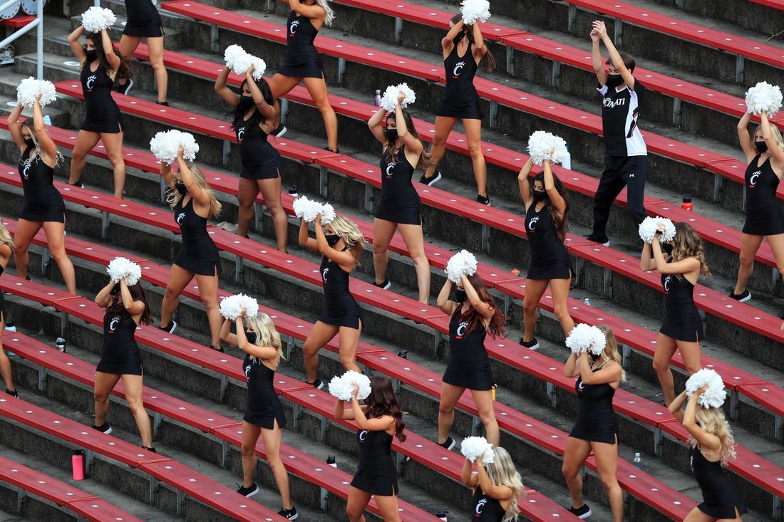 Sep 26, 2020; Cincinnati, Ohio, USA; A view of Cincinnati cheerleaders performing while socially distanced during the game between the Army Black Knights and the Cincinnati Bearcats in the second half at Nippert Stadium. Mandatory Credit: Aaron Doster-USA TODAY Sports