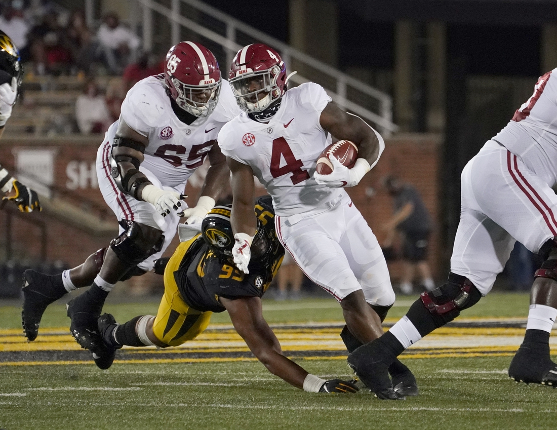 Sep 26, 2020; Columbia, Missouri, USA; Alabama Crimson Tide running back Brian Robinson Jr. (4) runs the ball against Missouri Tigers linebacker Z'Core Brooks (92) during the first half at Faurot Field at Memorial Stadium. Mandatory Credit: Denny Medley-USA TODAY Sports