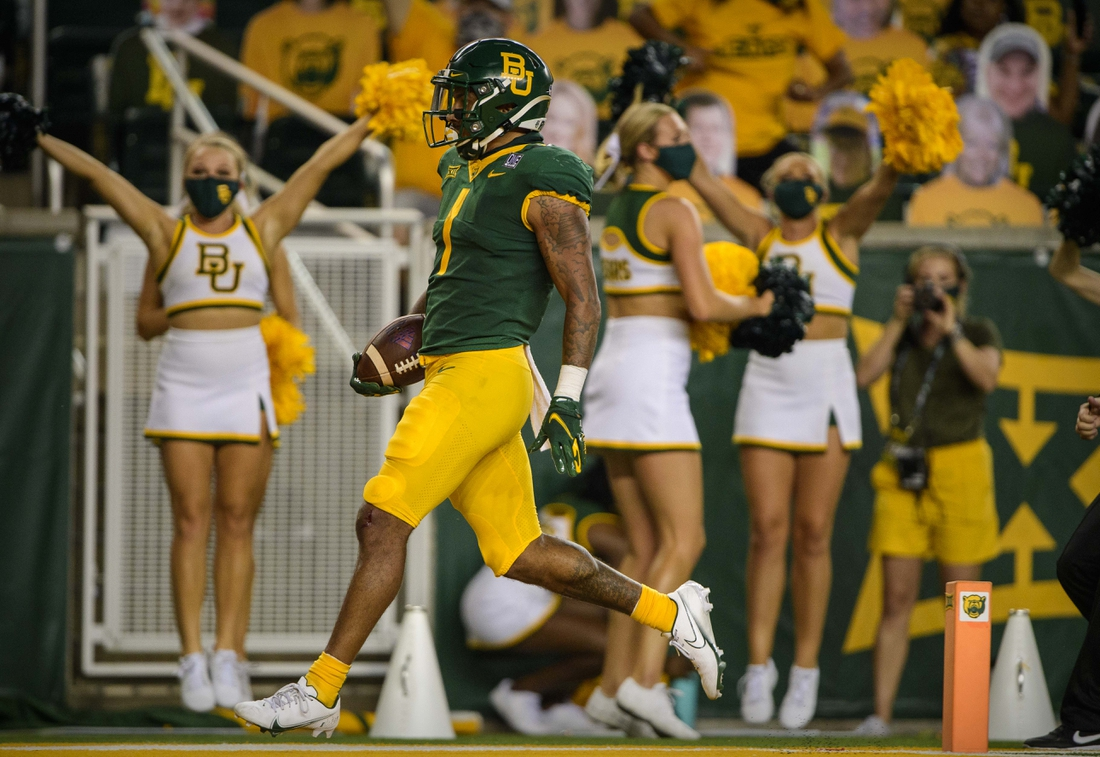 Sep 26, 2020; Waco, Texas, USA; Baylor Bears running back Trestan Ebner (1) returns a kick for a touchdown against the Kansas Jayhawks during the second half at McLane Stadium. Mandatory Credit: Jerome Miron-USA TODAY Sports