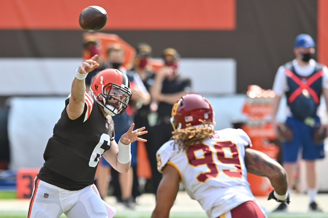 Sep 27, 2020; Cleveland, Ohio, USA; Cleveland Browns quarterback Baker Mayfield (6) throws a pass over Washington Football Team defensive end Chase Young (99) during the first quarter at FirstEnergy Stadium. Mandatory Credit: Ken Blaze-USA TODAY Sports