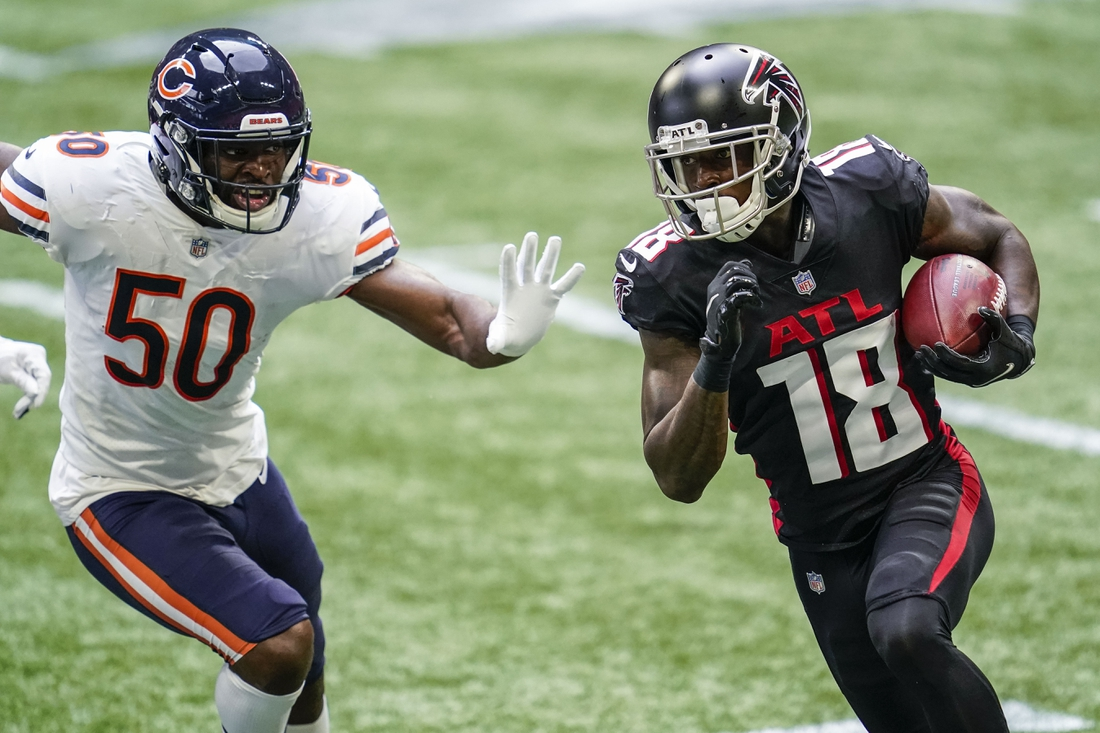 Sep 27, 2020; Atlanta, Georgia, USA; Atlanta Falcons wide receiver Calvin Ridley (18) runs against Chicago Bears linebacker Barkevious Mingo (50) during the first half at Mercedes-Benz Stadium. Mandatory Credit: Dale Zanine-USA TODAY Sports