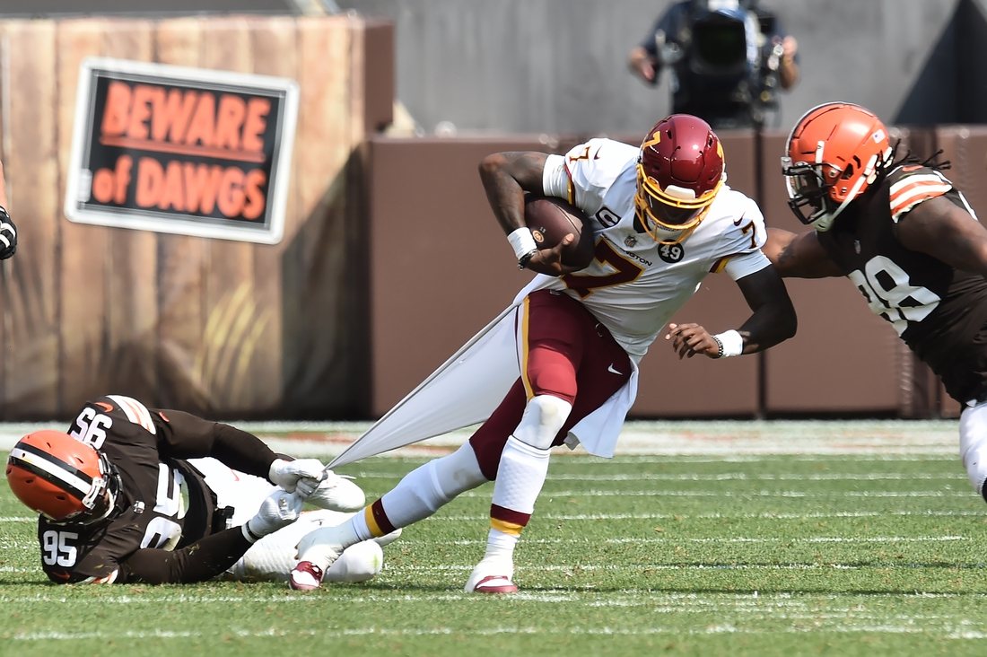 Sep 27, 2020; Cleveland, Ohio, USA; Cleveland Browns defensive end Myles Garrett (95) drags down Washington Football Team quarterback Dwayne Haskins (7) by the shirt for a sack during the first half at FirstEnergy Stadium. Mandatory Credit: Ken Blaze-USA TODAY Sports