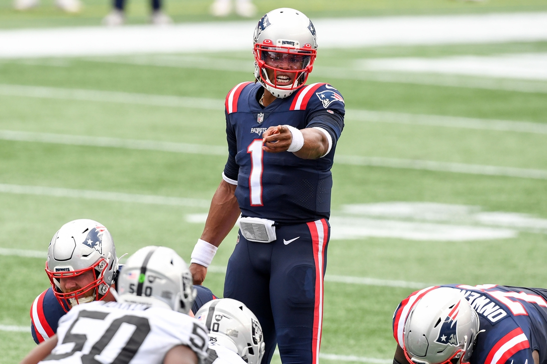 Sep 27, 2020; Foxborough, Massachusetts, USA; New England Patriots quarterback Cam Newton (1) calls a play against the Las Vegas Raiders during the second quarter at Gillette Stadium. Mandatory Credit: Brian Fluharty-USA TODAY Sports